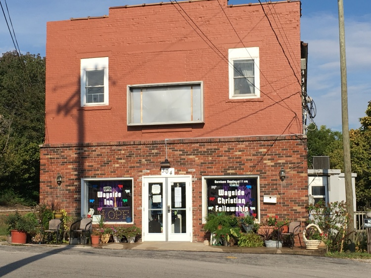 Here's a beautiful thing: the Wayside Inn and Shelter in tiny North Vernon, Indiana. In the United States, domestic violence and homelessness are as bad or worse in the countryside as in the cities, but almost all the programs to help people affected are in the cities. But not in this little town; a very dedicated band of volunteers and board members has built their own, with great help from townspeople, businesses, schools and community groups. They took on a deteriorating building (and are still rehabbing it) and got it ready to open in November 2014, with a worship space down and a shelter up. They now have 10 beds, have served over 400 people and provided more than 5000 nights of accommodation in a place that is safe, caring and increasingly equipped. Best of all, at least to us, it's run by one of our newest webcasters, who got us this photo and whose name appears now. (Jo Riley)