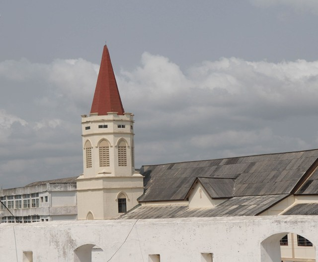 Christ the King Church, adjacent to Cape Coast Castle, was the first Anglican church in Ghana; it replaced an Anglican chapel above the slave dungeons.