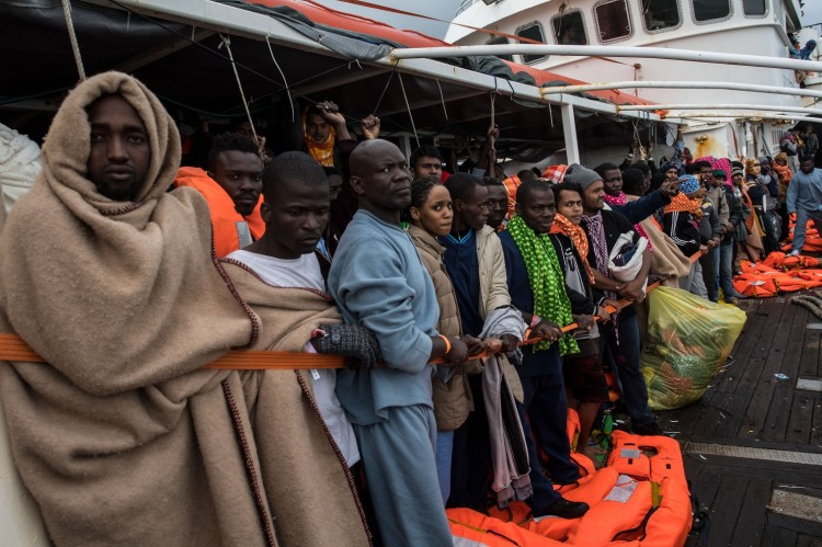 The bodies of 74 migrants washed ashore in western Libya Tuesday, the latest among thousands of refugees who drown every year trying to cross the Mediterranean to Europe; more than 4500 died last year and another 228 victims last month. The people above were lucky; a Spanish rescue ship picked them up on Saturday. (David Ramos/Getty Images)