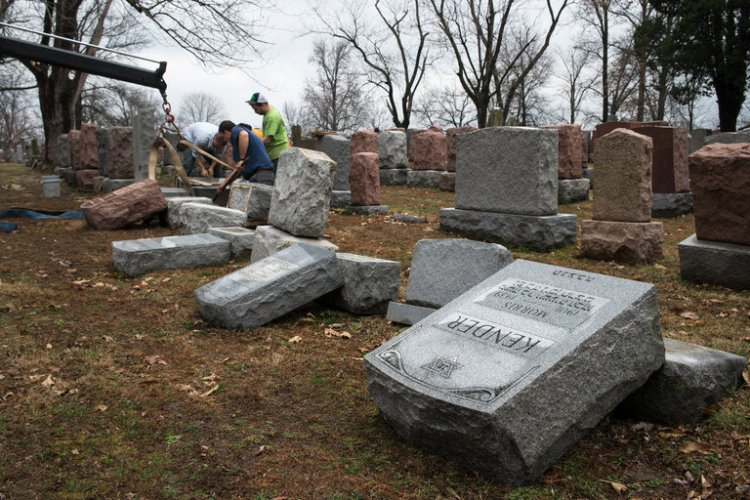 "Nearly 200 graves were vandalized last weekend at a Jewish cemetery in suburban St. Louis, Missouri. This is the anti-Semitic incident that finally got Donald Trump's condemnation. He and his closest advisers have been egging on young right-wing bigots for months, but once these pictures came out he wrapped himself in his son-in-law's prayer shawl long enough to release a statement, hoping, as Phineas T. Barnum supposedly said, ""There's a sucker born every minute."" (Nick Schnelle/The New York Times)"