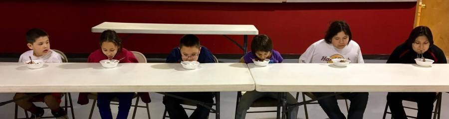 How do you eat if you can't use your hands? The GLORY kids decided that asking for help was a good idea – and thus they learned Lakota notions about interdependence. (The Rev. Lauren R. Stanley)