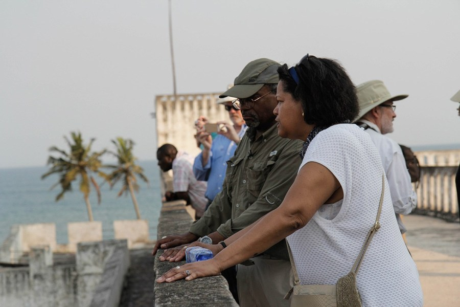 """Episcopal Presiding Bishop Michael Curry led a pilgrimage of reconciliation to Ghana last month to visit historic sites used in the slave trade, and The Episcopal Church's efforts through its Relief and Development fund to build up the local economy. Above, the PB and Massachusetts Suffragan Bishop Gayle Harris take a look at one of the British, Dutch and Portugese """"castles"""" which lined Africa's Atlantic coast to serve the slave trade's Middle Passage. Human beings were kidnapped in the countryside, taken to camps, then marched to the sea to be loaded onto ships destined for the Southern U.S. and Caribbean islands. Both bishops' ancestors likely passed through a place like this, along with an estimated 12-25 million others. (Reportage and photos by Lynette Wilson/Episcopal News Service)"""