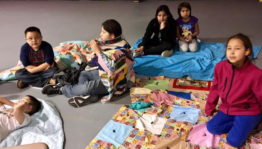 """You probably know that one of our support projects is the Episcopal Mission on the Rosebud Indian Reservation in South Dakota, where the youth outreach is called GLORY, God Loves Our Reservation Youth. At last week's meeting they heard a Bible story about a man who was sick and needed healing; his friends carried him on a pallet to Jesus, but with so many people they couldn't get in, so they cut a hole in the roof and lowered him down. That led to a game; if you were sick or hurt and couldn't use your hands, how would you tie your shoes? If you had only one leg, how would you get anywhere? In part it was a lesson about disability – but there was more to come. One boy said, """"I don't know how to tie my shoes – I always wear boots!"""" Which was true, and immediately provoked a little clerical improv; """"What would you do if you couldn't pull on your boots?"""" (The Rev. Lauren R. Stanley)"""