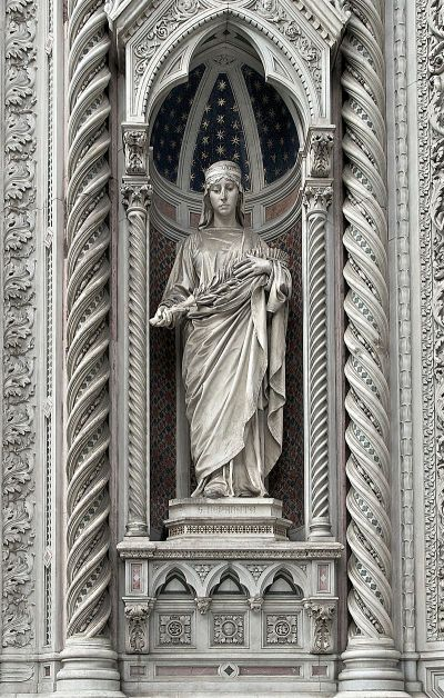 Statue of St. Reparata at the Duomo in Florence, Italy; if she existed she was a 4th Century virgin and martyr, patroness of Florence until the 1200s, when someone decided to depose her and set up the Virgin Mary and John the Baptist in her place. But Reparata got this lovely statue as a parting gift; look at that carving. (Wikipedia)
