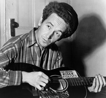 American folk singer Woody Guthrie in 1943: This Machine Kills Fascists. (Al Aumiller/New York World-Telegram and The Sun)